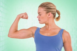 Composite image of muscular woman flexing her muscle