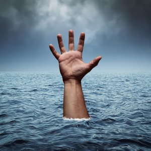 Drowning hand in stormy sea