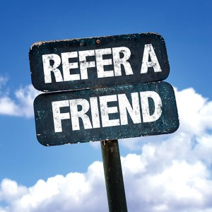 Refer a Friend sign with clouds on background